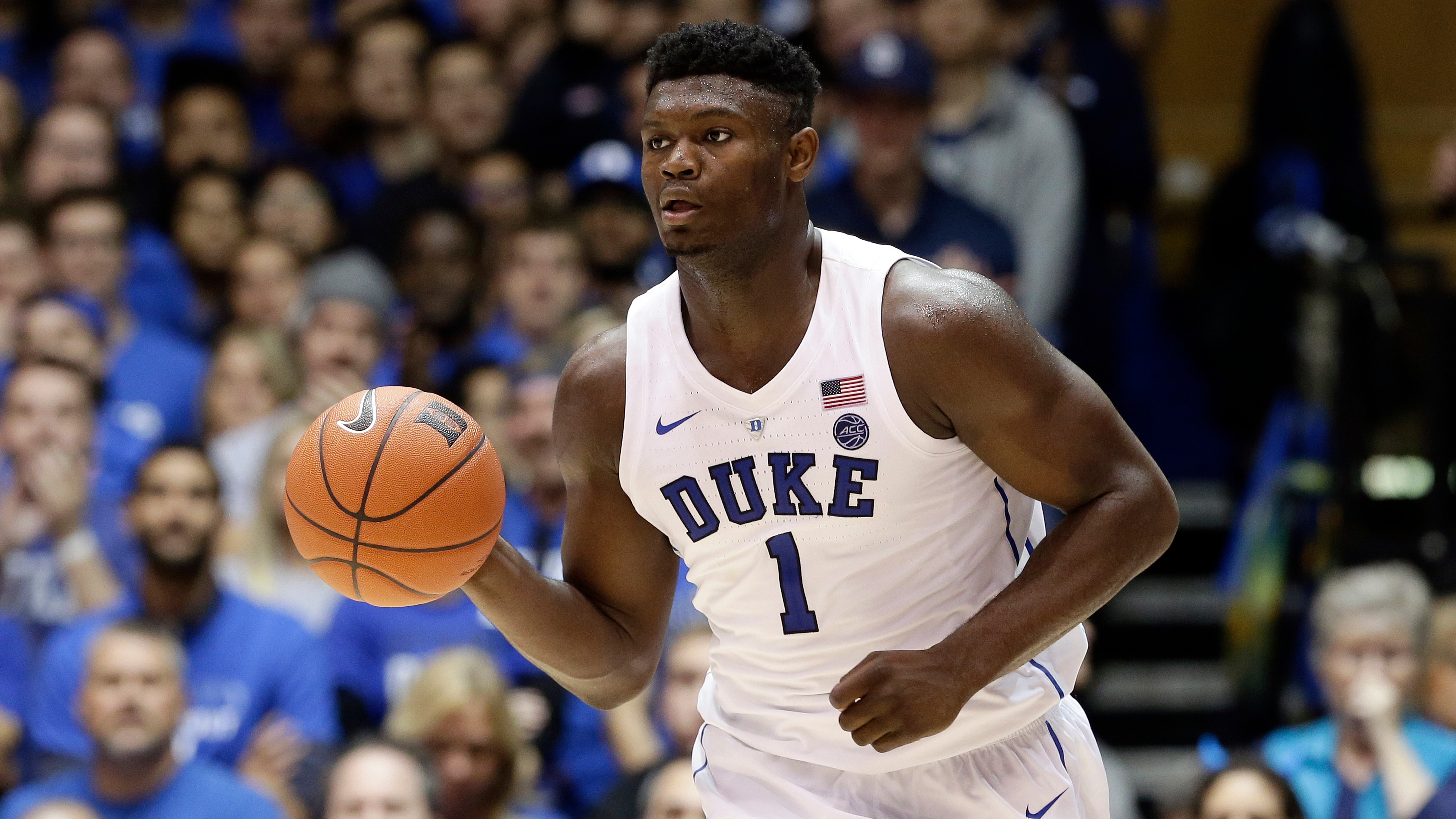 df3d6f7a2f27 Duke s Zion Williamson (1) dribbles against Army during the second half of  an NCAA college basketball game in Durham